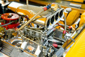 Powerful hot-rod engine bay with a large number of chromed parts — Photo