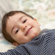 Stock Photo: Boy lay on bed