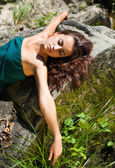 Young woman lying on the stones — Stock Photo