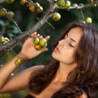 Portrait of young woman with wild apples — Stock Photo