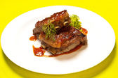Grilled meat ribs on white plate — Stock Photo
