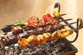 Barbecue with delicious grilled meat on grill — Stok fotoğraf
