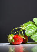 Bunch of ripe strawberries on black background — Stock Photo