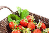 Juicy strawberries in the basket — Stock Photo