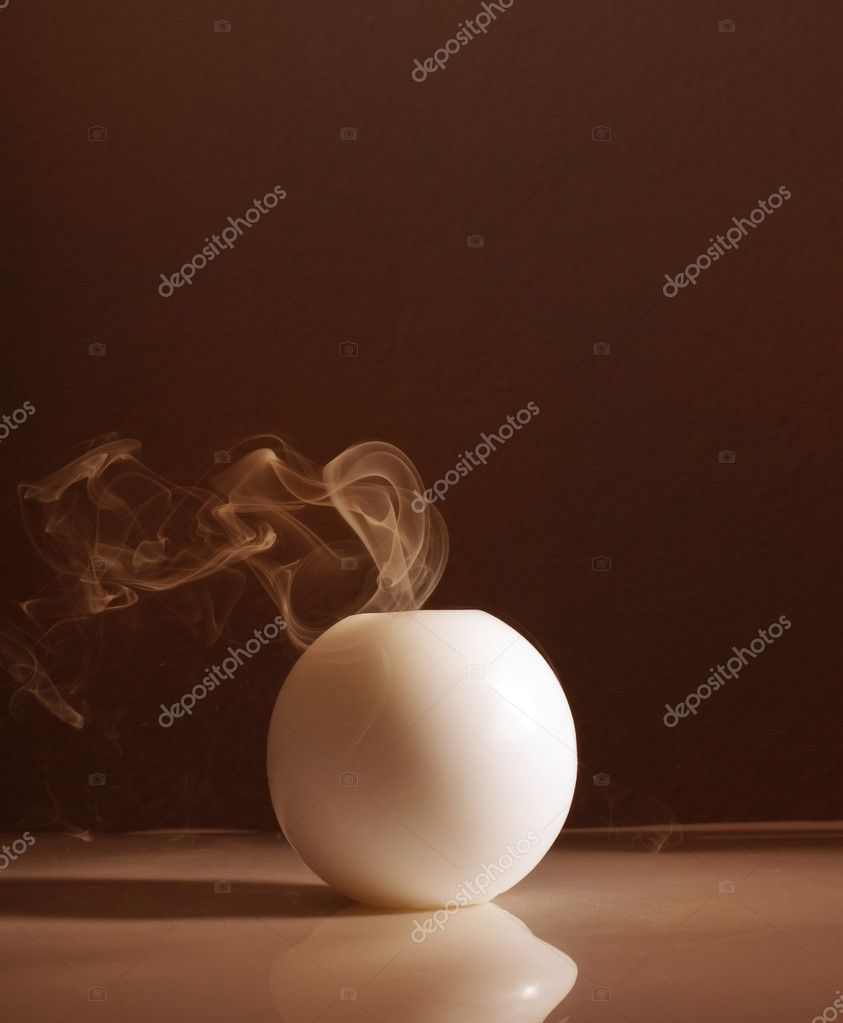 White candle and the smoke  Stock Photo #6104740
