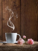 Cup of coffee with flowers — Stock Photo
