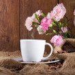 Stock Photo: Coffee and flowers