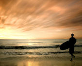 Silhouette of surfer — Stock Photo