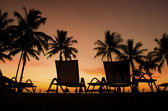 Row deckchairs on beach at sunset, Tanjung Aru, Malaysia — Stock Photo