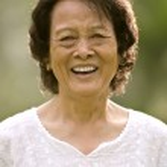 Senior asian woman smiling — Stock Photo