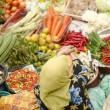 Vegetable market. Muslim woman selling fresh vegetables at Siti — Stock Photo #6172056