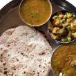 Traditional Indian cuisine vegetarian thali served in small bowl - Stock Photo