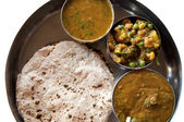 Traditional Indian cuisine vegetarian thali served in small bowl — Stock Photo
