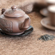 Tea pot, cups  and green tea - Foto Stock