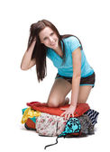 Girl packing her suitcase — Stock Photo