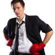 Businessman with boxing gloves. - Stock Photo