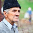 Old farmer with woolly hat — Stock Photo