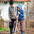 Senior farmer with grandson in the garden — Stock Photo