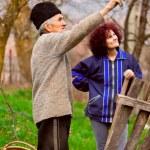 Senior farmer talking to his daughter — Stock Photo
