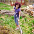 Young lady with rake spring cleaning garden — Stock Photo #5473383