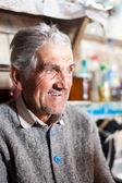 Senior farmer indoor — Stock Photo