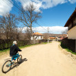 Boy riding a bike on rural road — Stock Photo #5488823