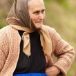 Candid portrait of a rural senior woman - Stok fotoğraf