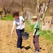 Mother and son farmers working on their land — Stock Photo #5591352