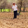 Young woman farmer planting — Stock Photo #5591353
