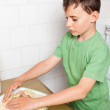 Little boy kneading — Stock Photo