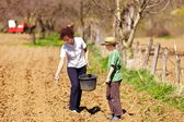 Mother and son farmers working on their land — Stock Photo