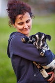 Young woman with baby goat outdoor — Stock Photo
