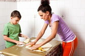 Mother and son cooking — Stock Photo