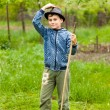 Little boy in hat and boots outdoor - Stock Photo