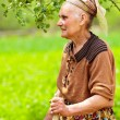 Old rural woman outdoor — Stock Photo