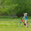 Boy with hat riding a bicycle — Стоковое фото