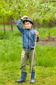 Little boy in hat and boots outdoor — Stock Photo