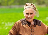 Old woman with kerchief outdoor — Stock Photo