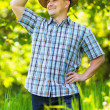 Young man in straw hat outdoor in a garden — Stock Photo #5686325
