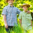 Stock Photo: Father and son outdoor in a forest