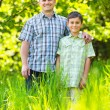 Father and son outdoor in a forest — Stock Photo #5686340