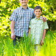 Royalty-Free Stock Photo: Father and son outdoor in a forest