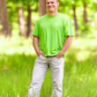 Young man in the forest — Stock Photo #5702874