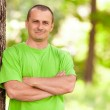 Young man in the forest — Stock Photo #5702885