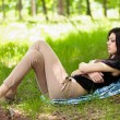 Beautiful girl sleeping outdoor - Stok fotoğraf