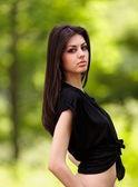Closeup portrait of a beautiful girl outdoor — Stock Photo