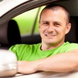 Young man driving new car — Stock Photo #5798590