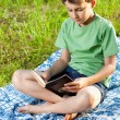Child reading a book outdoor — Stock Photo #5798606