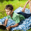 Child reading a book outdoor — Stock Photo #5798608