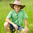 Cute kid with cowboy hat outdoor — Stock Photo